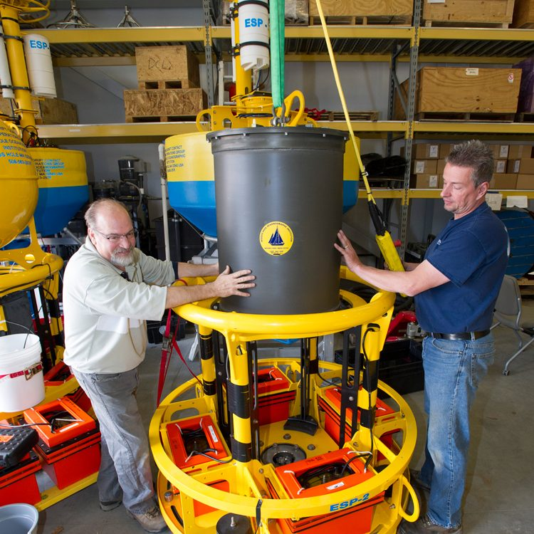 Bruce Keafer and Jim Dunn assembling an ESP unit for shipment. (Photo by Tom Kleindinst, Woods Hole Oceanographic Institution)
